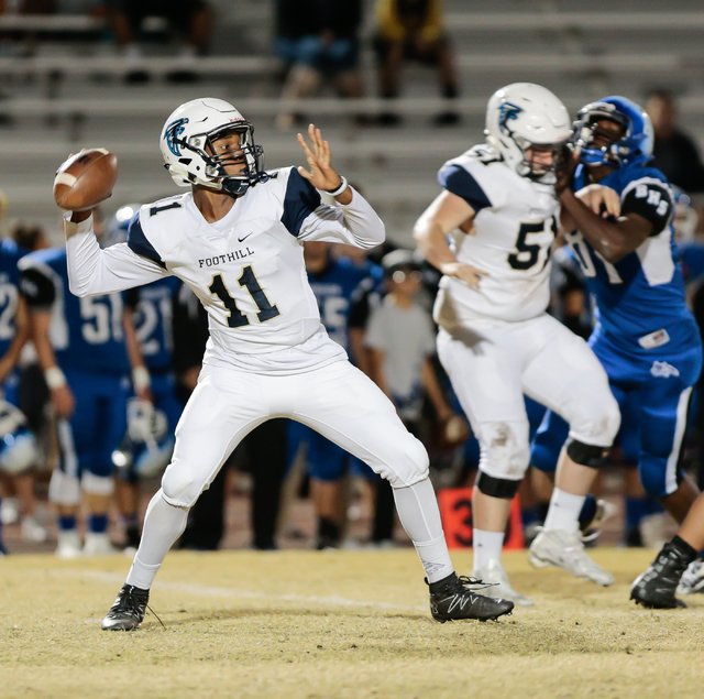 Foothill sophomore Jordan Wilson (11) steps back for a pass during a matchup with Basic High School at the Sunrise Region semifinal football game held at Basic High School in Henderson, Thursday,  ...