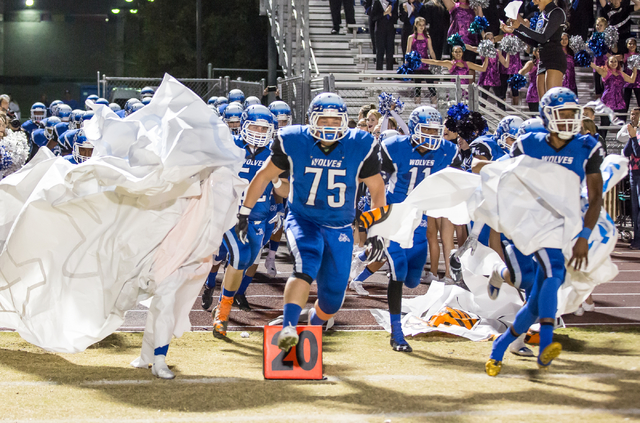 Basic High School football players take the field prior to a game against Foothill High School at the Sunrise Region semifinal football game held at Basic High School in Henderson, Thursday, Nov.  ...