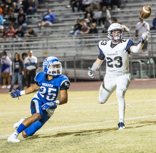 Basic junior Jordan Gallegos (25) looks on as Foothill senior Brandon Hargis (23) attempts to catch an overthrown pass during  the Sunrise Region semifinal football game held at Basic High School  ...