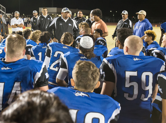 Basic High School head coach, Jeff Cahill talks to his players after a win against Foothill High School at the Sunrise Region semifinal football game held at Basic High School in Henderson, Thursd ...