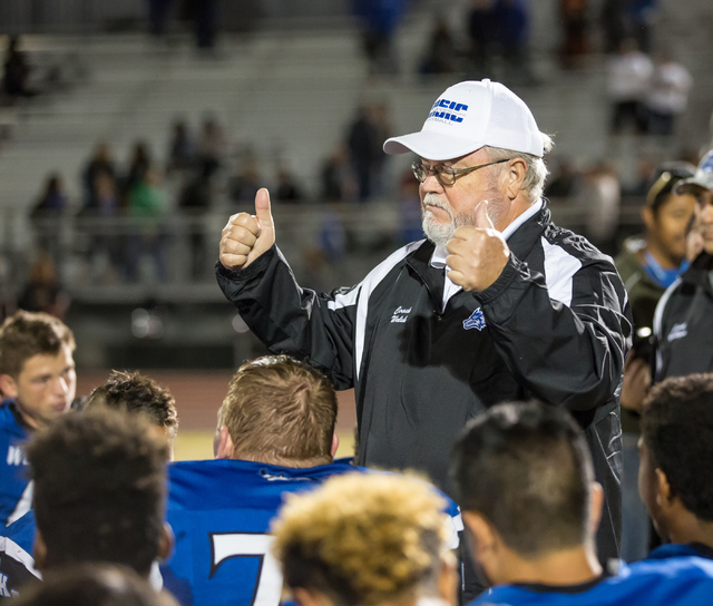 Basic High School varsity football coach Richard Welch gives a thumbs up to the players after a 45 to 6 win against Foothill High School at the Sunrise Region semifinal football game held at Basic ...