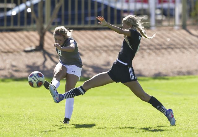 Arbor View's Hannah Ferrara, left, and Palo Verde's Alexis Lloyd fight for the ball during the Sunset Region girls soccer championship game at Bettye Wilson Soccer Complex in Las Vegas on Saturday ...