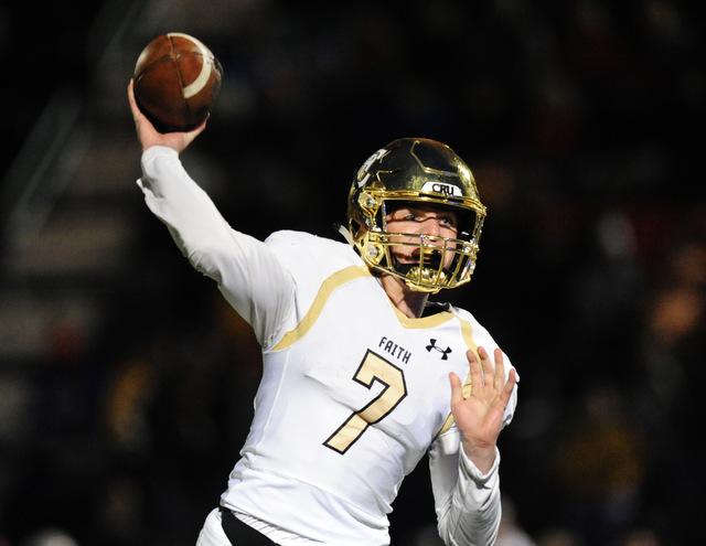 Faith Lutheran quarterback Sagan Gronauer passes against Bishop Gorman in the first half of their prep football game at Bishop Gorman High School in Las Vegas Friday, Nov. 18, 2016. Josh Holmberg/ ...