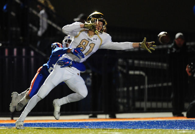 Faith Lutheran wide receiver Justin Taylor is unable to catch a pass while being wrapped up by Bishop Gorman coronrback Greg Oliver in the first half of their prep football game at Bishop Gorman H ...