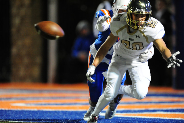Faith Lutheran wide receiver Eric Ho is unable to catch a pass while being wrapped up by Bishop Gorman safety wide receiver Greg Francis in the first half of their prep football game at Bishop Gor ...