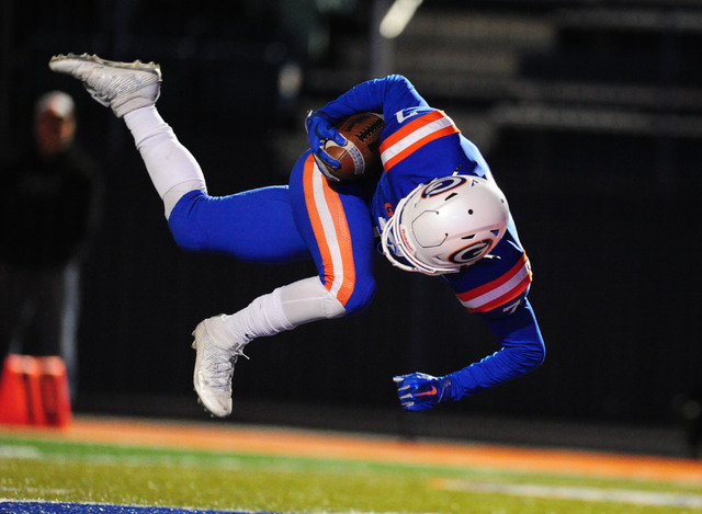 Bishop Gorman running back Biaggio Ali Walsh tumbles into the endzone for a touchdown after being tripped up by the Faith Lutheran defense in the first half of their prep football game at Bishop G ...