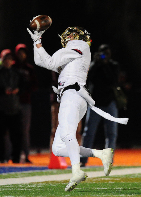 Faith Lutheran wide receiver Elijah Kothe catches a first down pass against Bishop Gorman in the first half of their prep football game at Bishop Gorman High School in Las Vegas Friday, Nov. 18, 2 ...