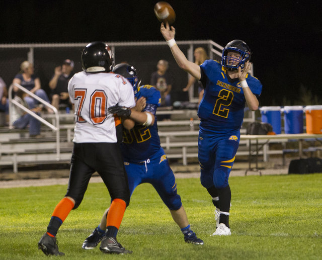 Pahranagat Valley Panthers quarterback Tabor Maxwell (2) throws the ball against Wells, Nevada players during the season opening eight-man high school football game in Alamo, Nevada on Friday, Aug ...
