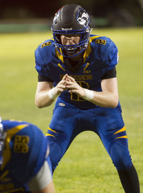 Pahranagat Valley Panthers quarterback Tabor Maxwell (2) hikes the ball against Wells, Nevada players during the season opening eight-man high school football game in Alamo, Nevada on Friday, Aug. ...