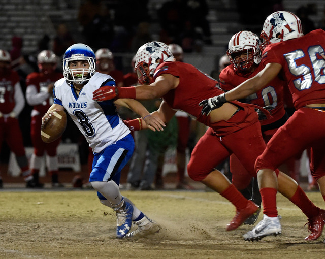 Basic quarterback Rasheem Newsome (8) attempts to avoid Liberty defense during a high school football game at Liberty High School Friday, Nov. 18, 2016, in Henderson. David Becker/Las Vegas Review ...