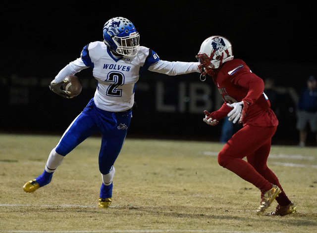 Basic's De'Shawn Eagles (2) stiff arms Liberty's Dominique Turner during a high school football game at Liberty High School Friday, Nov. 18, 2016, in Henderson. David Becker/Las Vegas Review-Journ ...