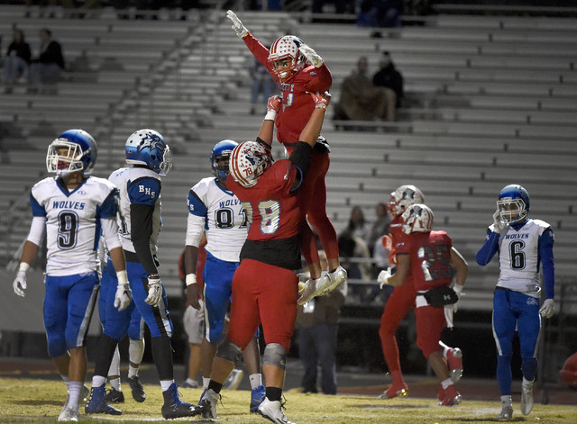 Liberty's Darion Acohido is raised by teammate Will Brewer (78) after Acohido score a touchdown against Basic during a high school football game at Liberty High School Friday, Nov. 18, 2016, in He ...