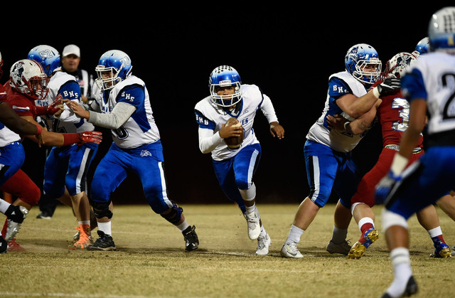 Basic quarterback Aaron McAllister finds a hole against Liberty during a high school football game at Liberty High School Friday, Nov. 18, 2016, in Henderson. David Becker/Las Vegas Review-Journal ...