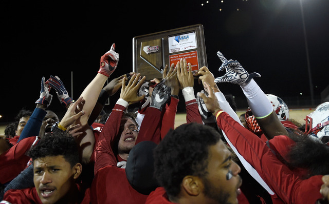 Liberty team members celebrate their 58-14 victory over Basic to win the Sunrise Regional championship after a high school football game at Liberty High School Friday, Nov. 18, 2016, in Henderson. ...