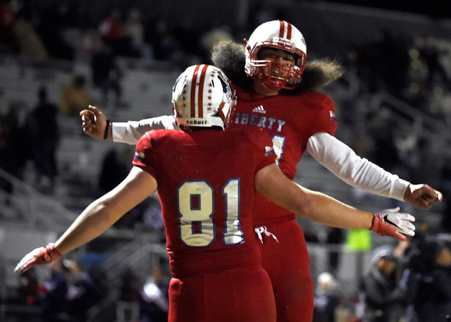 Liberty's Trenton Sipes (81) celebrates his touchdown with Chance Faitau during the second half of a high school football game against Liberty at Liberty High School Friday, Nov. 18, 2016, in Hend ...