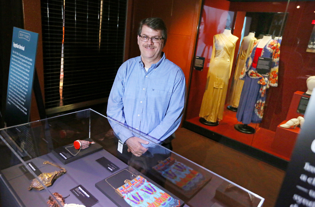 "Geoff Schumacher, director of content, stands among the ""Ready to Roar: evening fashions of the prohibition women"" display at The Mob Museum Thursday, Nov. 3, 2016, in Las Vegas. ..."