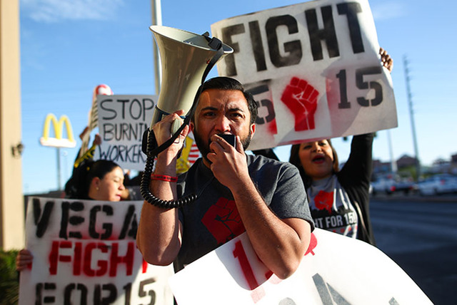 AJ Buhay leads a demonstration of fast-food workers and activists calling for worker's rights and an increased minimum wage outside of a McDonald's at Flamingo Road and Eastern Avenue in 2015. (Ch ...