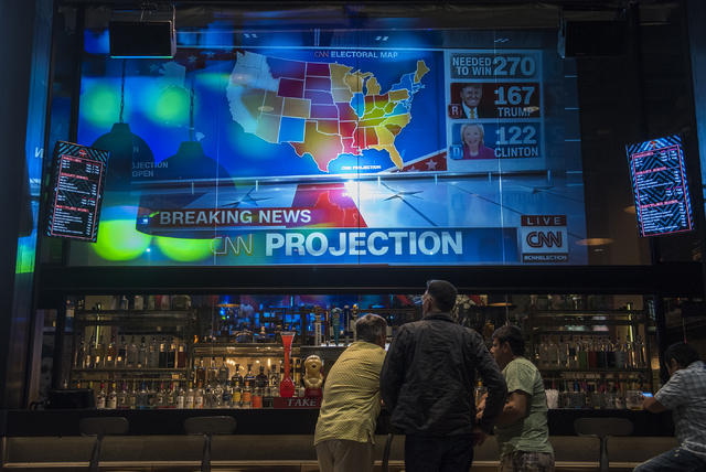 People hang out as early election results are displayed on TV during the Las Vegas Weekly's Question 2 watch party inside the Sake Rok restaurant in Las Vegas on Tuesday, Nov. 8, 2016. Martin S. F ...