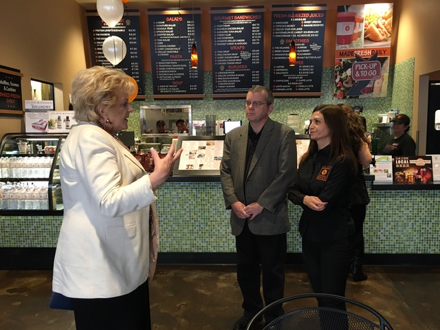 Debbie Roxarzade, far right and founder of Rachel's Kitchen, and franchise owner John Henderson, center, talk Sept. 26 with Las Vegas Mayor Caroline Goodman, who recognized Roxarzade for being in  ...