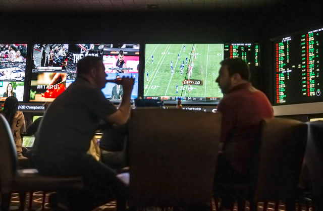 Customers watch Monday Night Football featuring the New York Giants and Cincinnati Bengals at The Race & Sports Book at Green Valley Ranch on Monday, Nov. 14, 2016, in Henderson. (Benjamin Hag ...