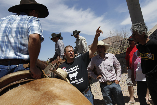 Ammon Bundy, middle, son of rancher Cliven Bundy, talks to his family's supporters near the BLM impound corral after the BLM agreed to release his family's a cattle near Bunkerville on April 12, 2 ...