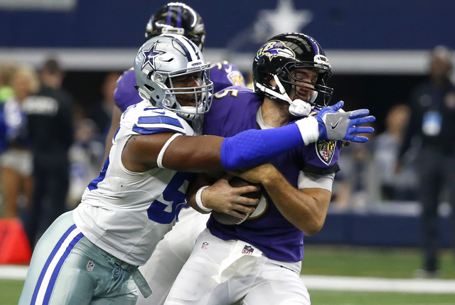 Dallas Cowboys defensive tackle David Irving (95) sacks Baltimore Ravens quarterback Joe Flacco (5) in the second half of an NFL football game, Sunday, Nov. 20, 2016, in Arlington, Texas. (AP Phot ...