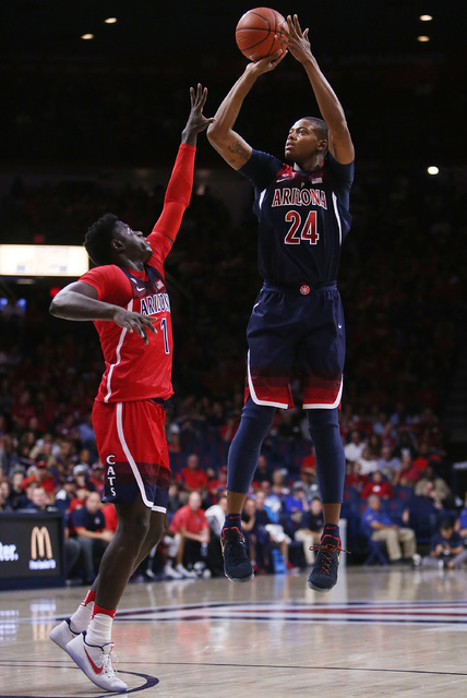 Arizona Wildcats forward Ray Smith (24) shoots a jumper over Arizona Wildcats guard Rawle Alkins (1) during the first half of the University of Arizona Wildcats men's basketball team's Red/Blue sc ...