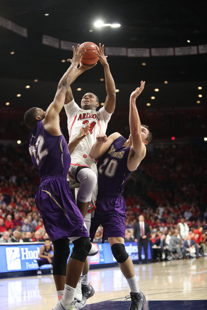Arizona Wildcats forward Ray Smith drives the basketball during the Wildcats 86-35 win over College of Idaho on Nov. 1, 2016 in Tucson, AZ. C(University of Arizona)