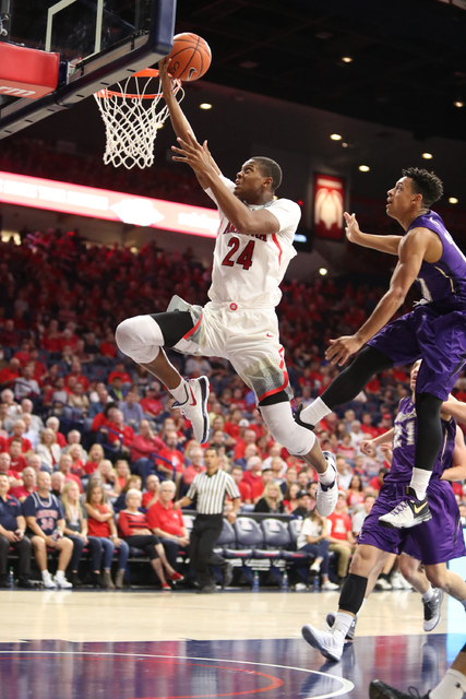 Arizona Wildcats forward Ray Smith drives the basketball during the Wildcats 86-35 win over College of Idaho on Nov. 1, 2016 in Tucson, AZ. (University of Arizona)