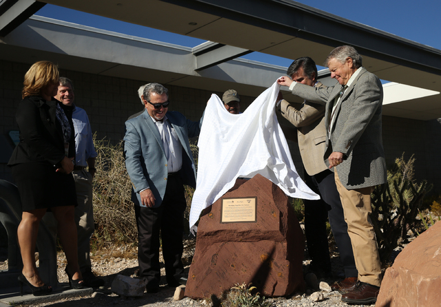 Joel Laub, right, chairman of the board of trustees for the Nature Conservancy, unveils a new monument celebrating the organization, as well as the Bureau of Land Management and Summerlin develope ...