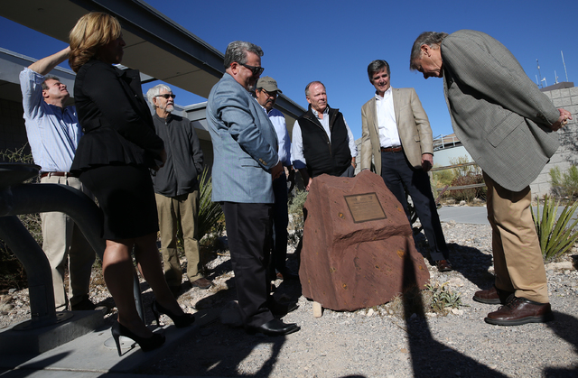 Joel Laub, right, chairman of the board of trustees for the Nature Conservancy, reads the inscription on the new monument celebrating the Nature Conservancy, Bureau of Land Management and Summerli ...