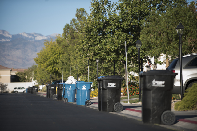 Both recycling and trash bins are shown in a northwest Las Vegas neighborhood on Thursday, Oct. 6, 2016. Waste-disposal company Republic Services of Southern Nevada has been negotiating with the c ...