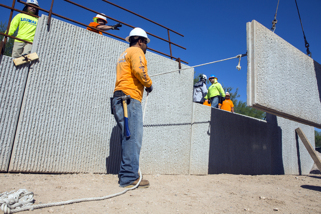 Humberto Sarmiento guides a retaining wall during training class at Laborers Local 872 training center on Monday, Aug. 29, 2016. Nevada Department of Transportation, Kiewit Infrastructure West Com ...
