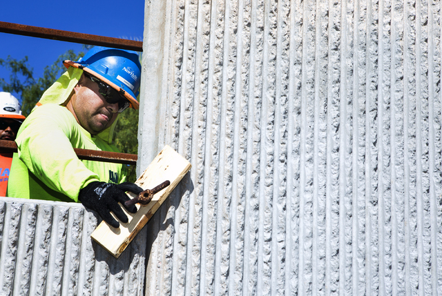 Roberto Gonzalez clamps down retaining wall during training class at Laborers Local 872 training center on Monday, Aug. 29, 2016. Nevada Department of Transportation, Kiewit Infrastructure West Co ...