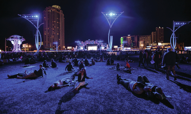 Attendees relax on the grass before John Legend performs on the main stage during the Rock in Rio USA music festival in Las Vegas on Saturday, May 16, 2015. (Chase Stevens/Las Vegas Review-Journal ...