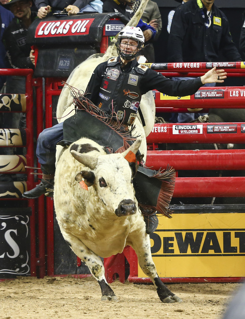 Cooper Davis rides Catfish John while competing during round 5 of the Professional Bull Riders World Finals at the T-Mobile Arena in Las Vegas on Sunday, Nov. 6, 2016. Davis became the world champ ...