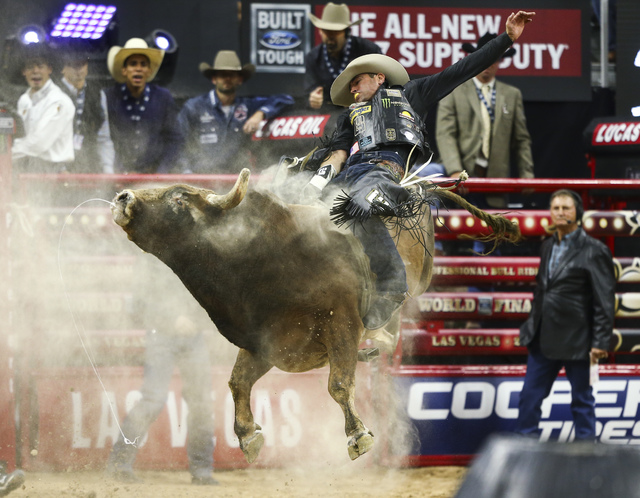 Guilherme Marchi rides Red Rover while competing during the championship round of the Professional Bull Riders World Finals at the T-Mobile Arena in Las Vegas on Sunday, Nov. 6, 2016. Chase Steven ...