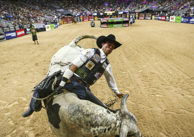 Marco Antonio Eguchi rides Mystical while competing during the championship round of the Professional Bull Riders World Finals at the T-Mobile Arena in Las Vegas on Sunday, Nov. 6, 2016. Chase Ste ...