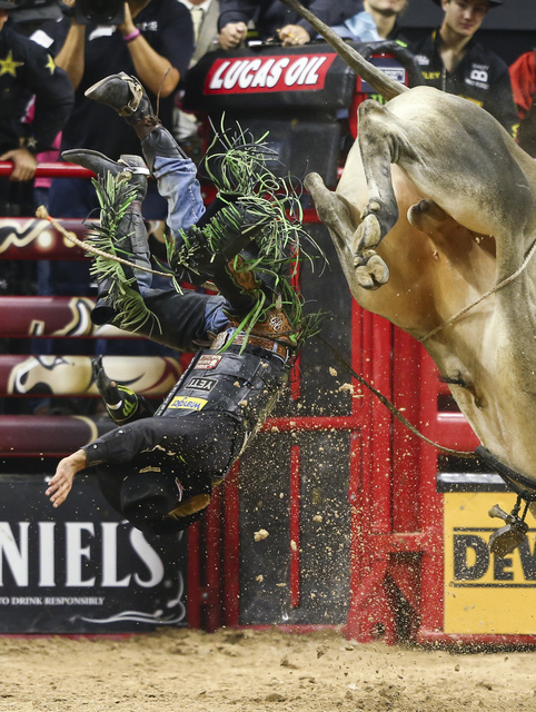 J.B. Mauney is bucked off of Jack Shot while competing during the championship round of the Professional Bull Riders World Finals at the T-Mobile Arena in Las Vegas on Sunday, Nov. 6, 2016. Chase  ...