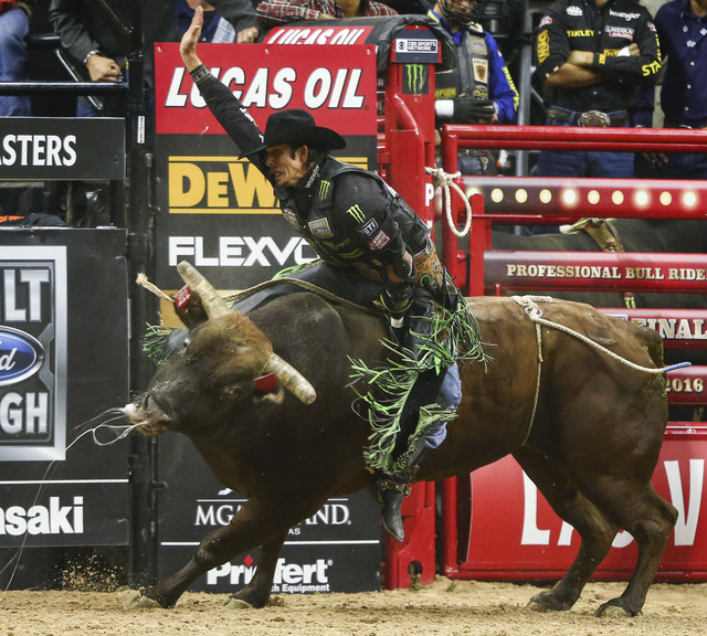 J.B. Mauney rides Stone Sober while competing during the championship round of the Professional Bull Riders World Finals at the T-Mobile Arena in Las Vegas on Sunday, Nov. 6, 2016. Chase Stevens/L ...