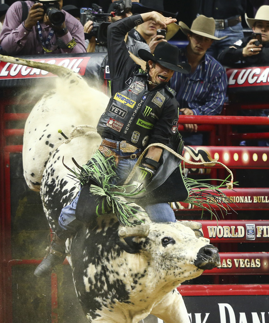 J.B. Mauney rides Air Time while competing during round 5 of the Professional Bull Riders World Finals at the T-Mobile Arena in Las Vegas on Sunday, Nov. 6, 2016. Chase Stevens/Las Vegas Review-Jo ...