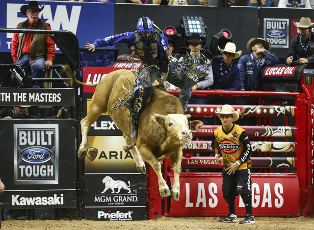 Ryan Dirteater rides Brutus while competing during the championship round of the Professional Bull Riders World Finals at the T-Mobile Arena in Las Vegas on Sunday, Nov. 6, 2016. Dirteater was nam ...