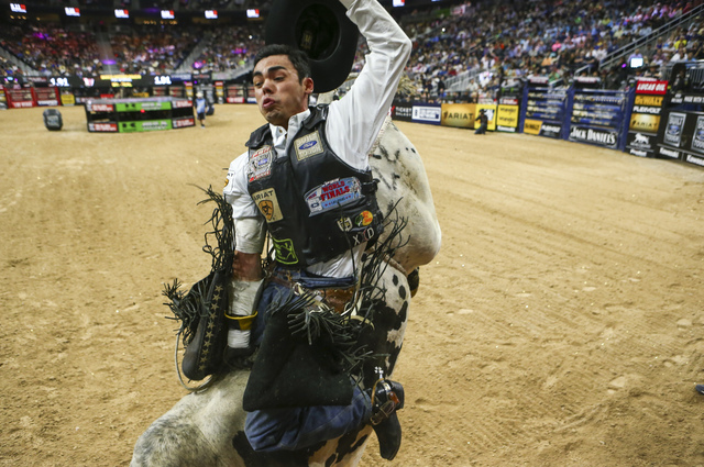 Marco Antonio Eguchi rides Mystical during the final round of the Professional Bull Riders World Finals at T-Mobile Arena on Sunday. (Chase Stevens/Las Vegas Review-Journal Follow @csstevensphoto)