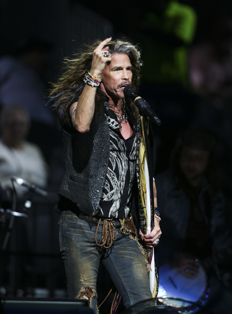 Steven Tyler of Aerosmith performs at the start of the fourth day of the Professional Bull Riders World Finals at the T-Mobile Arena in Las Vegas on Saturday, Nov. 5, 2016. Chase Stevens/Las Vegas ...