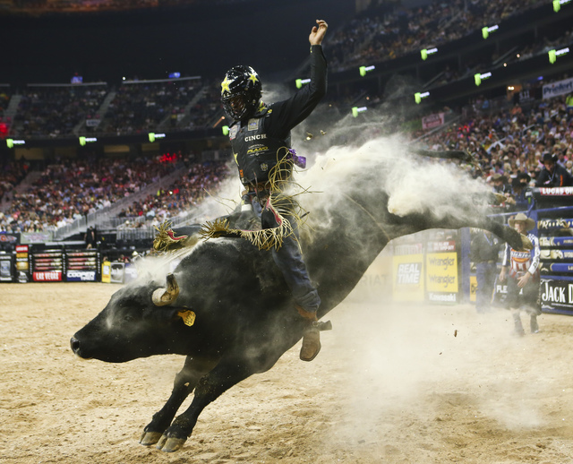 "Valdiron de Oliveira rides ""Flight Plan"" while competing during the fourth day of the Professional Bull Riders World Finals at the T-Mobile Arena in Las Vegas on Saturday, Nov. 5 ..."