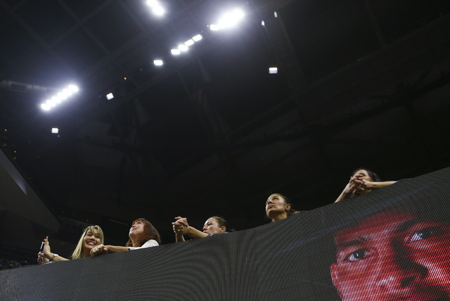 Fans watch the action as bull riders compete during the fourth day of the Professional Bull Riders World Finals at the T-Mobile Arena in Las Vegas on Saturday, Nov. 5, 2016. Chase Stevens/Las Vega ...