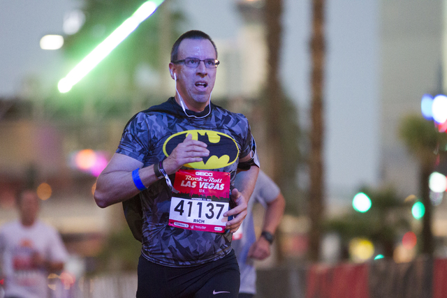 Richard Trepanier runs the 10K run in the annual Rock 'n' Roll Marathon at the Strip near The Mirage hotel-casino on Sunday, Nov. 13, 2016, in Las Vegas. Erik Verduzco/Las Vegas Revi ...