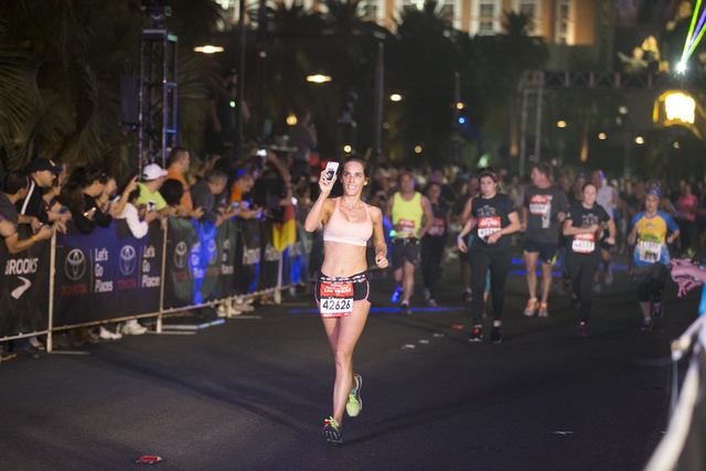 Paloma Bilson completes the 10K run in the annual Rock 'n' Roll Marathon at the Strip near The Mirage hotel-casino on Sunday, Nov. 13, 2016, in Las Vegas. Erik Verduzco/Las Vegas Rev ...