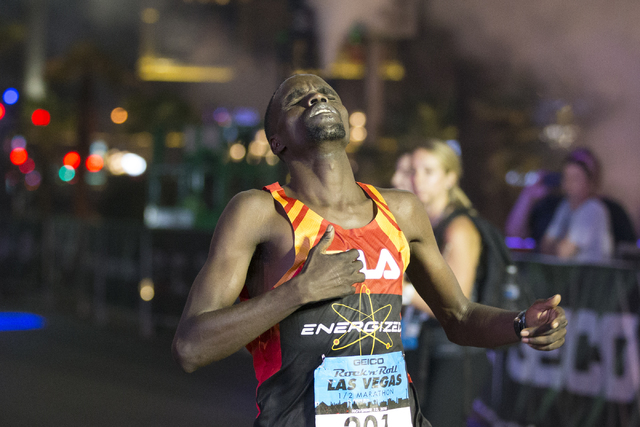 William Kibor completes the half-marathon run in first place for men during the annual Rock 'n' Roll Marathon at the Strip near The Mirage hotel-casino on Sunday, Nov. 13, 2016, in L ...