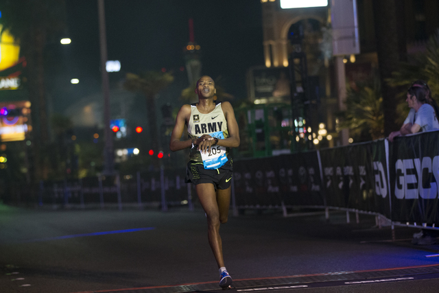 Elkanah Kibet completes the half-marathon run for men in second place during the annual Rock 'n' Roll Marathon at the Strip near The Mirage hotel-casino on Sunday, Nov. 13, 2016, in  ...